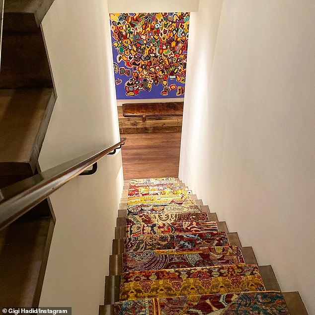 Going down: Her staircase was covered in carpet, with a different pattern for each step, culminating in a small brown bench and a blue painting from Weiner covered in abstract splotches