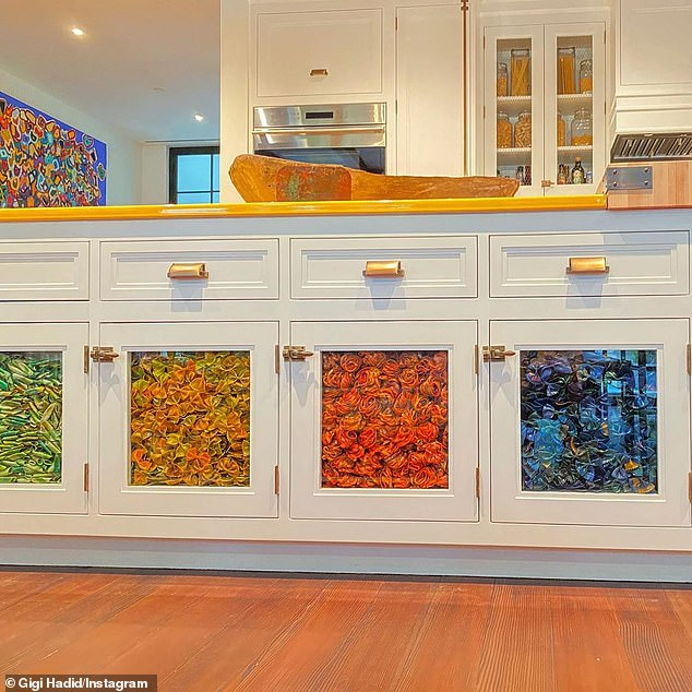 Tasty!: She livened up the room with display cabinets on her island that were filled with dyed decorative past in multiple colors, created by Linda Miller Nicholson